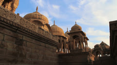 India Rajasthan Jaisalmer Royal Cenotaphs red domes and columns  Stock Footage