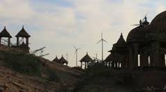 India Rajasthan Jaisalmer Royal Cenotaphs and windmills in silhouette  Stock Footage