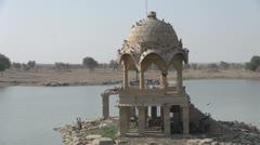India Rajasthan Jaisalmer Gadisar Lake chhatri with birds  Stock Footage