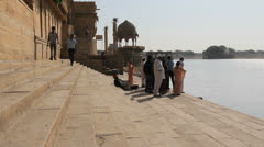 India Rajasthan Jaisalmer lake and steps near wall  Stock Footage