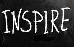"Stock Illustration of ""inspire"" handwritten with white chalk on a blackboard"
