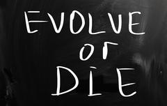 """evolve or die"" handwritten with white chalk on a blackboard Stock Illustration"