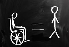 handicapped sign drawn with chalk on a blackboard - stock illustration