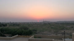 India Rajasthan Jaisalmer magenta sunset from sandstone wall zoom  Stock Footage