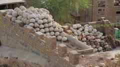 India Rajasthan Jaisalmer stacked clay pots behind wall  Stock Footage