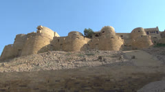 India Rajasthan Jaisalmer fortress walls from below  Stock Footage