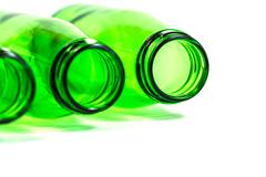 Three Green Bottles on White Background with focus on Right Bottle - stock photo