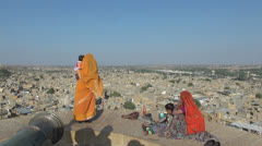 India Rajasthan Jaisalmer cannon view point woman in gold sari  Stock Footage