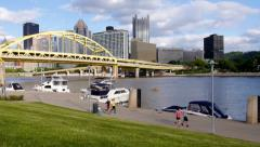 People Jog near Pittsburgh's North Shore Stock Footage