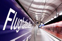 Underground train station at airport Stock Photos
