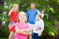 Stock Photo of summer: cute girl with american flags