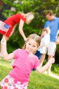 Stock Photo of summer: patriotic girl with usa flags