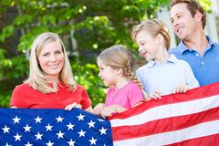 Stock Photo of summer: family with american flag