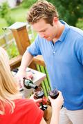 summer: man pouring glass of wine - stock photo