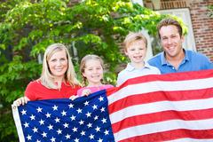 summer: family with american flag - stock photo