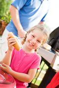summer: girl hungry for hot dog dinner - stock photo
