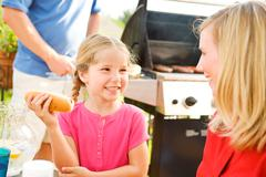 Stock Photo of summer: girl talking with mother before eating