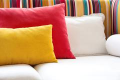 Colorful cushions in sofa. - stock photo
