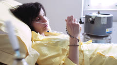 Patient in hospital prays god with rosary  - lung cancer - depression Stock Footage