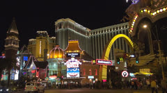 The Venetian tower and traffic street by night, Casino Royale, The Palazzo USA Stock Footage