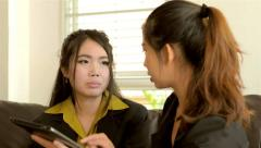 Young Asian businesswomen discussing work with a tablet computer Stock Footage