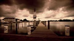 Marina on Solomons Island with Dark Clouds - Sepia Tone HD Video - stock footage