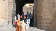 India Rajasthan Jaisalmer entering gate past tall iron door  Stock Footage