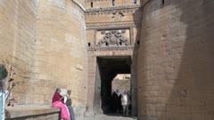 India Rajasthan Jaisalmer fortress gate women and tuk tuk cab  Stock Footage