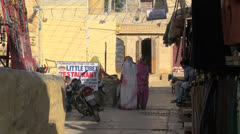 India Rajasthan Jaisalmer narrow street and hanging clothes  Stock Footage