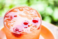 Red cherry on cold mix fruits juice soda Stock Photos