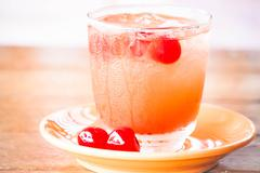 light mix fruits juice soda drink on table - stock photo