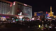 Aerial view of traffic street and Flamingo, Bally's, Paris resort by night SUA Stock Footage