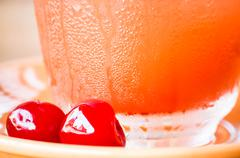 Red cherry decorate iced mix fruits juice Stock Photos
