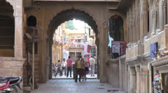 India Rajasthan Jaisalmer Patwa haveli sunlit tunnel and wares zoom out  - stock footage