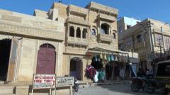 India Rajasthan Jaisalmer wares hung below elegant balcony 4 Stock Footage