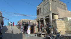 India Rajasthan Jaisalmer shop in cluttered corner  Stock Footage