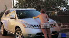 Woman washing the hood of her car. Stock Footage