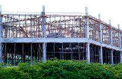 Construction site with enforced concrete steel frames rising up Stock Photos