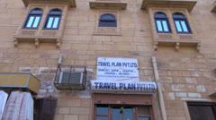 India Rajasthan Jaisalmer blue windows and hung shirts  Stock Footage
