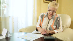Mature woman filling out tax form - stock footage