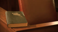 CU Holy Bible, Zoom Out to Buffalo Courtroom - stock footage