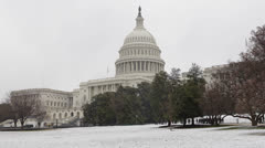 Snow Lawn United States Capitol Building Washington DC US Congress People Walk Stock Footage