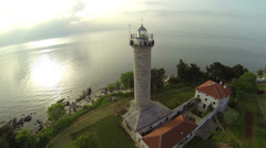 AERIAL: Lighthouse at sunrise Stock Footage