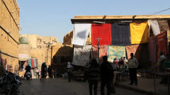 India Rajasthan Jaisalmer cloth wares hanging near city wall  - stock footage