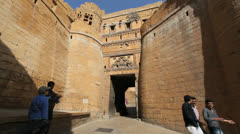 India Rajasthan Jaisalmer rounded walls and motorcycles at gate  Stock Footage
