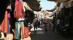 India Rajasthan Jaisalmer street market and hanging goods  Stock Footage