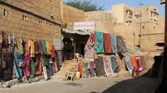 India Rajasthan Jaisalmer silk wares on wall  Stock Footage
