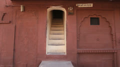 India Rajasthan Fort Pokaran framed stairs in mauve wall  Stock Footage