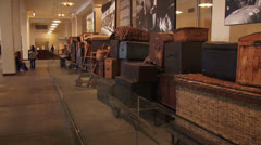 Luggage display at Ellis Island Museum Stock Footage