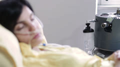 Patient with a cancer is sleeping in a hospital bed - sad wake up Stock Footage